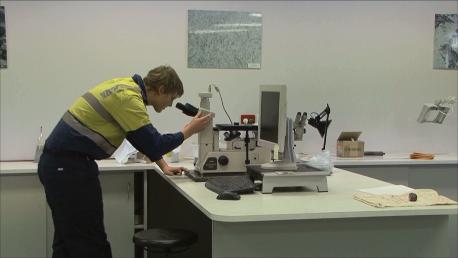 Lab Technician Using Microscope