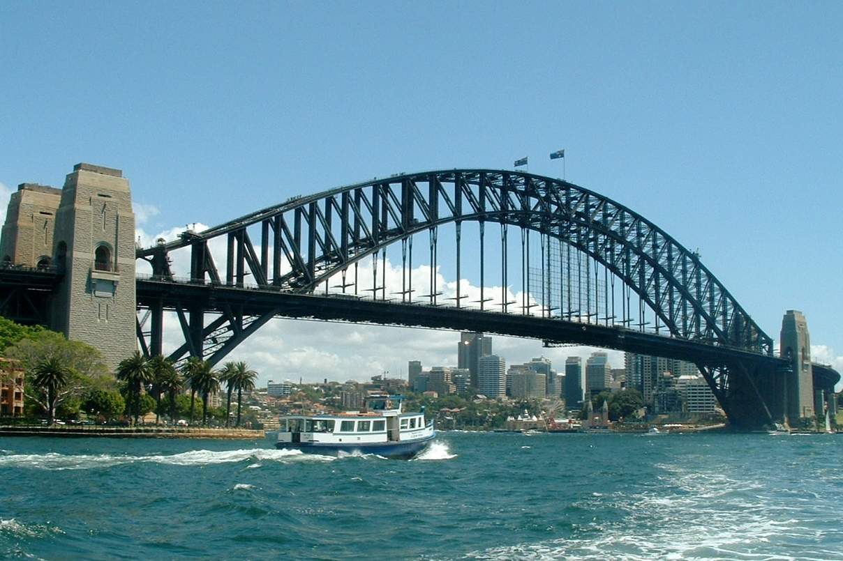 Sydney Harbour Bridge on sunny day with boat in foreground
