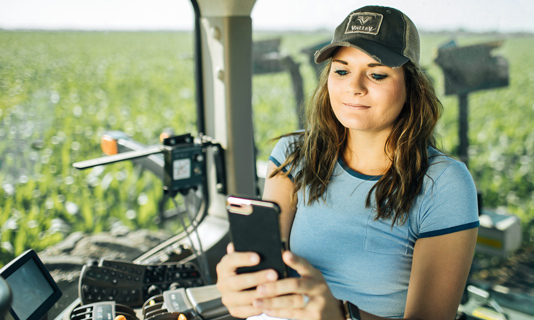 woman using phone to access pivot technology