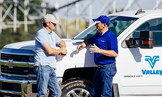 valley irrigation dealer speaking with a customer outside a truck