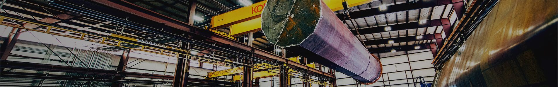 Utility pole hoisted in warehouse