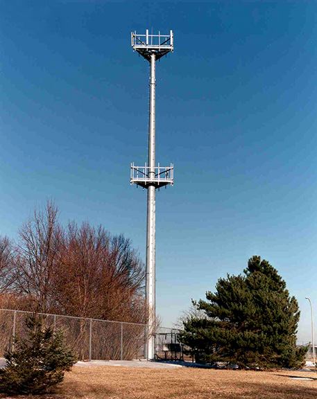 Communications tower with two levels